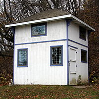 Steel Buildings Tall Wooden Shed with Door and Windows